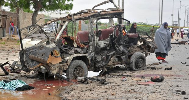 The aftermath of    a suicide car bomb attack in Mogadishu, Somalia. Militant jihadist group al-Shabaab claimed responsibility. Photograph: Mohamed Abdiwahab/AFP/Getty Images
