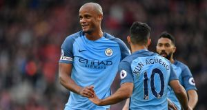 Manchester City's Vincent Kompany celebrates with Sergio Aguero after the striker's goal against Southampton.  Photograph: Tony O'Brien/Reuters