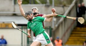 Limerick's Gearóid Hegarty with Daithí Burke of Galway during the semi-final at the Gaelic Grounds. Photograph: Donall Farmer/Inpho