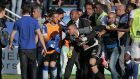 Security staff hold back Lyon goalkeeper Anthony Lopes  during scuffles at half-time after   Bastia supporters  invaded the pitch. The Ligue 1 match at  the Armand Cesari stadium was abandoned at half-time. Photograph:  Pascal Pochard-Casabianca/AFP/Getty Images