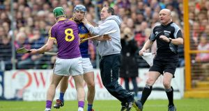Wexford manager Davy Fitzgerald and Aidan Nolan clash with Jason Forde of Tipperary. Photograph: Ryan Byrne/INPHO
