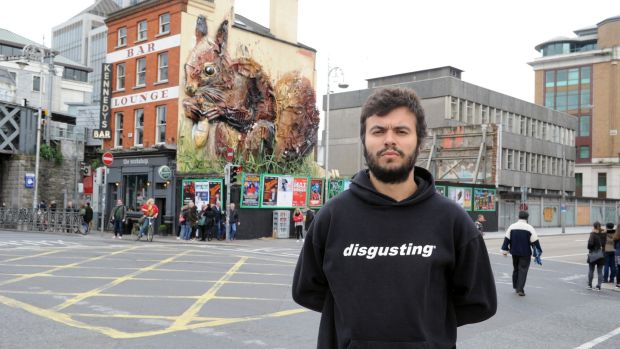 Artist Artur Bordalo picutred at Butt Bridge, Dublin infront of his art installation called Red Squirrel. Photograph: Aidan Crawley/The Irish Times