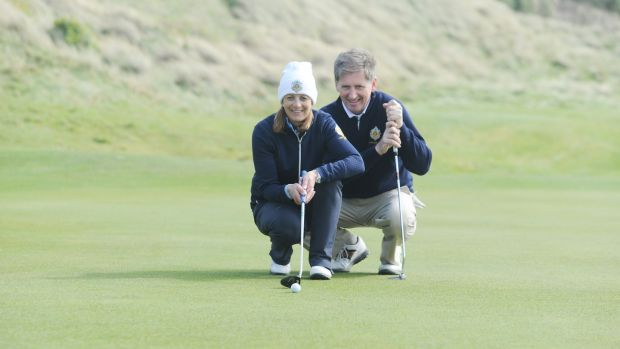 Andrea Fitzgerald, lady captain of the Castle Golf Club, Dublin, and Barry McConville, captain. Photograph: Aidan Crawley
