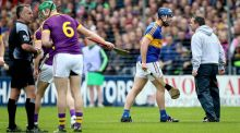 Wexford manager Davy Fitzgerald confronts Tipperary's  Jason Forde during the semi-final at Nowlan Park. Photograph: Ryan Byrne/Inpho