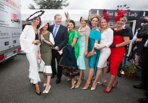 Taoiseach Enda Kenny, with contestants from the most stylish lady competition. Photograph: Inpho