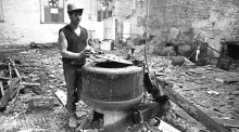 A demolition worker, Myles Behan, with one of the old laundry machines at Tara Street Baths and Wash-house. Photograph: Paddy Whelan