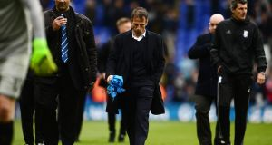 Gianfranco Zola cuts a dejected figure as he leaves the pitch at the final whistle at St Andrews on Monday. Photograph: Harry Trump/Getty Images