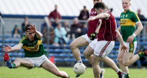 Galway's Dessie Connolly scores the first goal of the game despite the effort's of Tom Leo O'Sullivan of Kerry. Photograph: Donall Farmer/Inpho