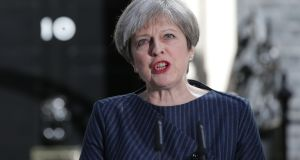 British prime minister Theresa May makes a statement to the nation in Downing Street. Photograph: Daniel Leal-Olivias/AFP