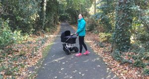 "Mary Jennings walking with her son's buggy in the park: ""It's all about trying to build activity into our day without consciously calling it exercise,"" she says"
