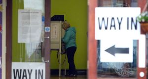 A voter stands at a booth inside a polling station as she prepares to cast her vote in Belfast during the last UK general election – on May 7th, 2015. Photograph: Paul Faith/AFP/Getty Images
