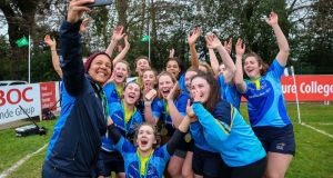 Coach Sophie Spence takes a selfie with her DCU players after they played UL in the  Irish Rugby National Sevens Festival in Terenure College. Photograph: Gary Carr/Inpho