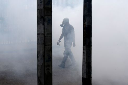 VENEZUELAN PROTEST: A demonstrator walks through a cloud of tear gas during the 'mother of all marches' against Venezuelan president Nicolás Maduro, in Caracas. Photograph: Carlos Garcia Rawlins/Reuters