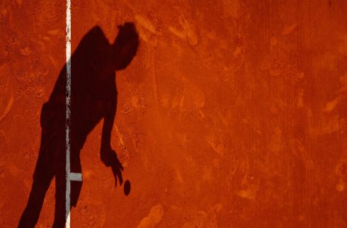 SHADOW PLAY: Spain's Rafael Nadal serves against Britain's Kyle Edmund in their second-round match at the Monte Carlo Masters, in Monaco. Photograph: Clive Brunskill/Getty Images