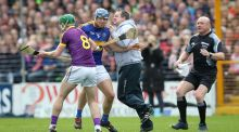 Wexford manager Davy Fitzgerald gets involved in an on-field  altercation with Tipperary's Jason Forde during the National Hurling League semi-final at Nowlan Park. Photograph: Ryan Byrne/Inpho