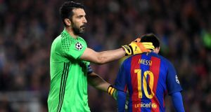 Gianluigi Buffon of Juventus pats Lionel Messi of Barcelona on the back during their quarter-final second leg match at Camp Nou. Photograph: Shaun Botterill/Getty Images