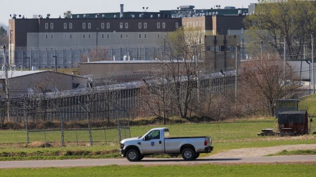 A prison vehicle drives past the Souza Baranowski Correctional Center in Shirley, Massachusetts where Hernandez was found dead in his jail cell. Photo: Brian Snyder/Reuters