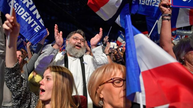 Supporters of French presidential candidate Marine Le Pen at her campaign rally in Marseille on Wednesday night. Photograph: Jeff J Mitchell/Getty Images