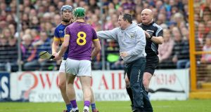 Wexford manager Davy Fitzgerald clashes with Jason Forde of Tipperary. Photo: Ryan Byrne/Inpho