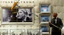 A worker cleans the windows of the Ivanka Trump Boutique at Trump Tower in New York. Photograph:  Getty