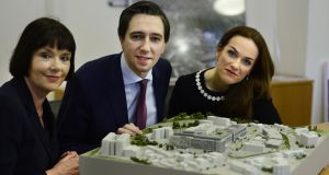 Kay Connolly chief operations officer of St Vincent's Hospital, Minister for Health Simon Harris,  and Master of the National Maternity Hospital  Dr Rhona Mahony with the model  of the new Natonal Maternity Hospital at St Vincent's University Hospital earlier this year. Photograph: Cyril Byrne
