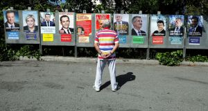 Decisions, decisions: A man looks at campaign posters of the 11th candidates running in the 2017 French presidential election, in Saint Andre de La Roche, near Nice, France. Photograph: Reuters/Eric Gaillard