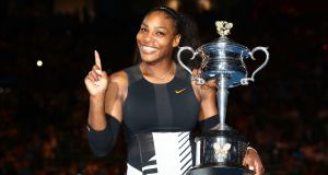 Serena Williams poses with the Daphne Akhurst Trophy after winning the Australian Open in January 2017. Williams announced this week that she was  two months pregnant during the tournament. Photograph:  Clive Brunskill/Getty Images