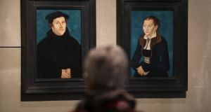 Portraits of Martin Luther and his wife Katharina von Bora at  The Luther Effect: 500 Years of Protestantism in the World exhibition at Martin-Gropius-Bau, Berlin. Photograph: Sean Gallup/Getty