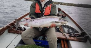 Armagh angler Liz Dermott proudly displays her Lough Melvin salmon