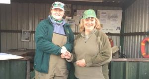 Julie Gerry, left, presenting Ruth Arrell (Derry), with her prize after winning the Leinster trial on Lough Lene