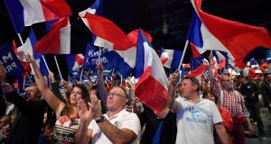 Far-right supporters attend a presidential campaign rally by Front National leader Marine Le Pen in Marseille, as polling day looms in one of the most unpredictable French elections. Photograph: Jeff J Mitchell/Getty Images