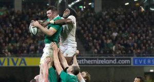 Peter O'Mahony rises high to steal a crucial late lineout against England's Maro Itoje at the Aviva. The two Lions will renew rivalry tomorrow at the same venue. Photograph: James Crombie/Inpho