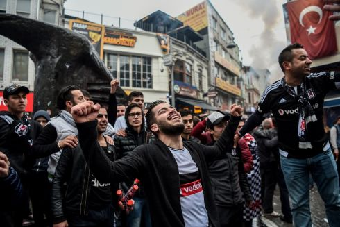 FAN OUT: Beşiktaş supporters cheer their team before their Uefa Europa League second-leg quarter-final match against Lyon, in Istanbul, Turkey. Photograph: Ozan Kose/AFP/Getty Images