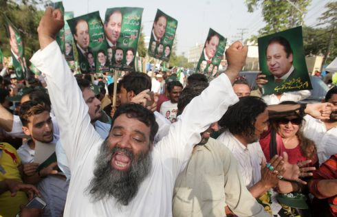 CORRUPTION RULING: Supporters of Pakistan's prime minister Nawaz Sharif celebrate after he survived a corruption ruling by Pakistan's supreme court, in Lahore. Photograph: Mohsin Raza/Reuters