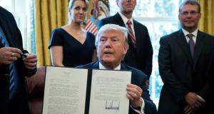 At a ceremony in the White House on Thursday, US president Donald Trump signed an executive order directing a review  of steel imports. Photograph: Shawn Thew/EPA