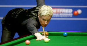 Neil Robertson at the Betfred Snooker World Championships where he had a 10-4 victory over Thai debutant Noppon Saengkham. Photograph: Richard Sellers/PA Wire