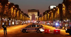 Police secure the Champs Elysee thoroughfare in Paris after one policeman was killed and another wounded in a shooting on Thursday night. Photograph: Christian Hartmann/Reuters