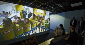 Reporters watch an audiovisual presentation at the Clermont Museum at Stade Marcel Michelin.