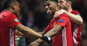 Marcus Rashford celebrates scoring with Manchester United team-mates Anthony Martial and Michael Carrick during the Europa League quarter-final second leg at Old Trafford. Photograph:  Laurence Griffiths/Getty Images