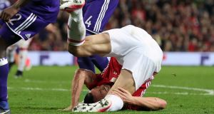 Manchester United's Zlatan Ibrahimovic  suffers an injury during the  Europa League quarter-final second leg  match against Anderlecht at  Old Trafford. Photograph:  Martin Rickett/PA Wire
