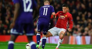 Manchester United  defender Marcos Rojo suffered a  knee injury in this chal with Anderlecht's  Alexandru Chipciu during the  Europa League quarter-final second leg  at Old Trafford. Photograph: Oli Scarff/AFP/Getty Images