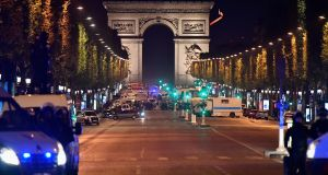 Police officers secure the area after a gunman opened fire on Champs Elysees. One police officer has been killed, and a second injured by a gunman on The Champs Elysees. Photograph: Jeff J Mitchell/Getty Images