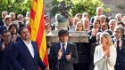 Carles Puigdemont,  president of Catalonia, and his vice-president, Oriol Junqueras (left), at a  ceremony in Barcelona to make official their commitment to hold a referendum on independence. Photograph: Toni Albir