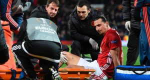 Zlatan Ibrahimovic gets treatment after injuring his knee during the Uefa Europa League quarter-final against Anderlecht. Photo: Oli Scarff/Reuters