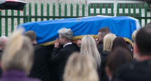 The remains of Stephen Lynch during his funeral at St Aidan's Church, Brookfield, Tallaght, Dublin. Photograph: Collins