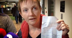 Cork woman Vera Twomey at Dublin airport holding up a prescription for  cannabis which she received in Barcelona. Screengrab: The Irish Times