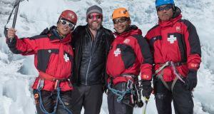 Rory McHugh with three of the icefall doctors: these highly skilled mountaineers are among the coolest individuals we've met in Nepal