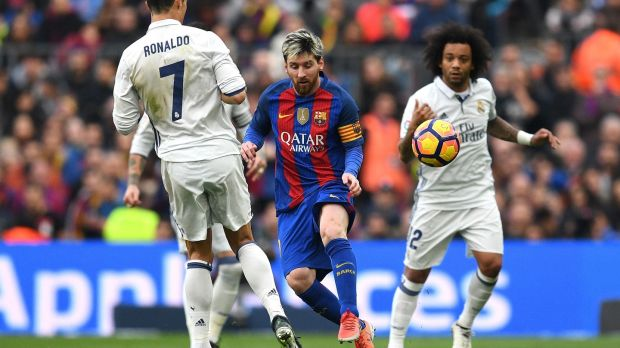 Messi goes past Ronaldo during the first Clasico of the season. Photo: David Ramos/Getty Images