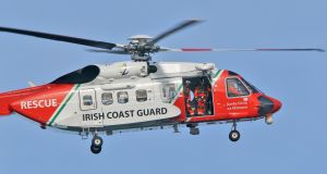 A Coastguard helicopter taking part in the search for the missing crew members of Rescue 116. Photograph: Colin Keegan, Collins Dublin