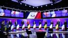 The election candidates take part in a television show: The government has mobilised 50,000 police and 7,000 soldiers to protect polling stations. Photograph: Martin Bureaumartin Bureau/AFP/Getty Images